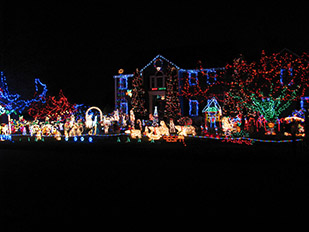 cars line up windmill hill to see the elaborate holiday light display set to music designed by resident will sanders